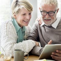 The Goldton at Southaven   Senior couple using tablet