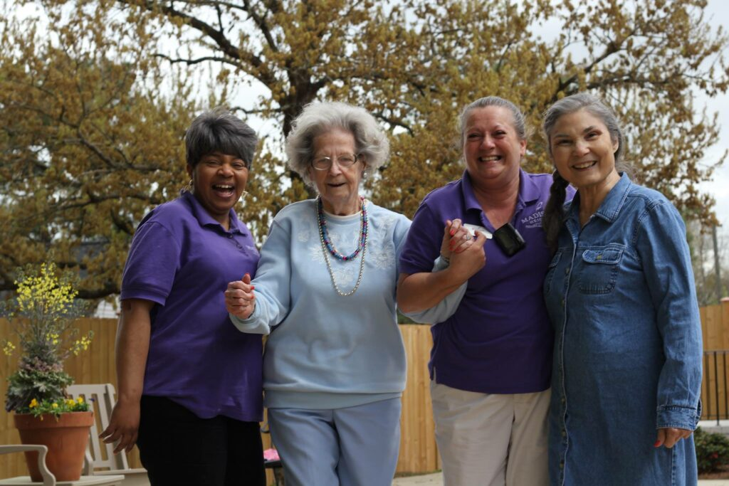 Atlas Senior Living | Senior with caregivers