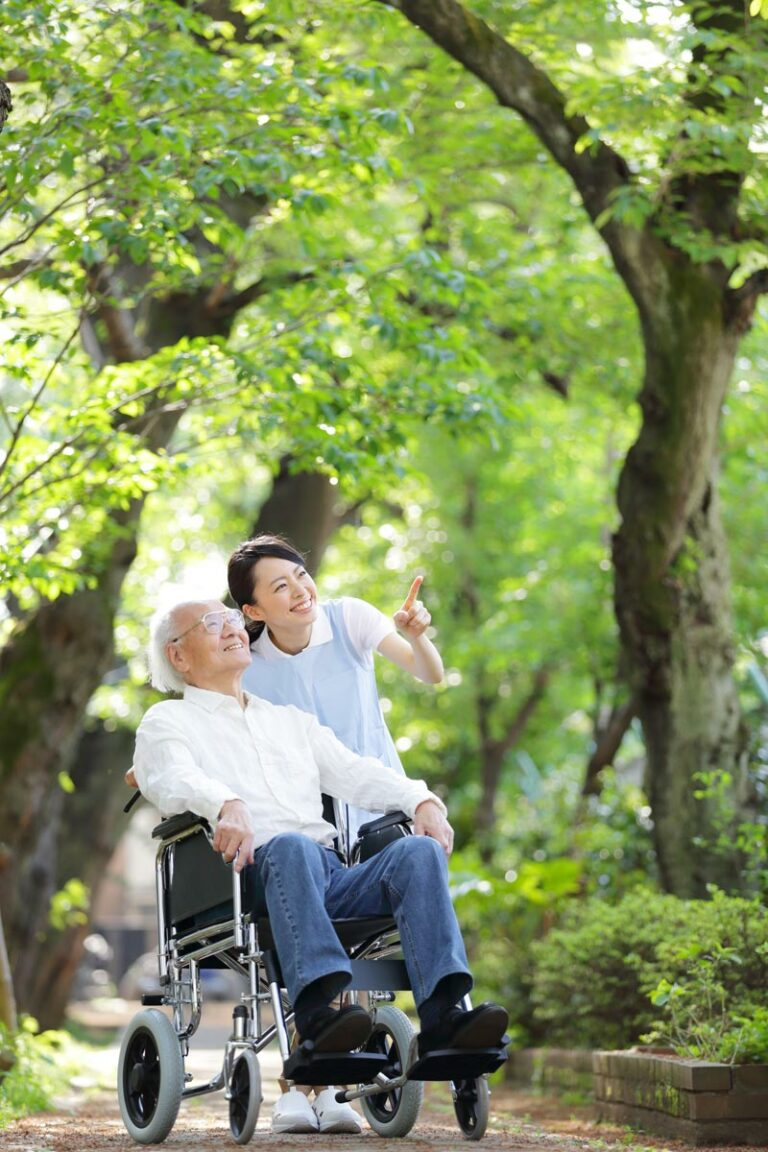 The Goldton at St. Petersburg | Happy senior and caregiver on nature trail