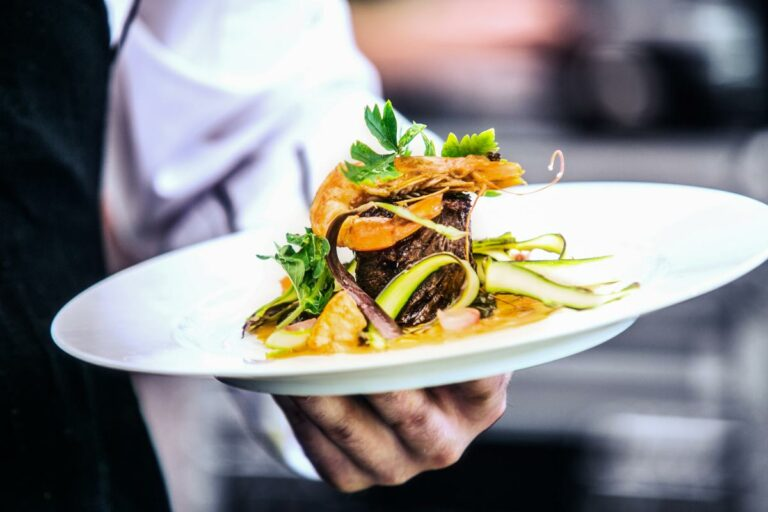 The Goldton at St. Petersburg | Chef holding dinner plate