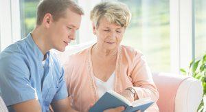 Atlas Senior Living | Grandma reading with grandson