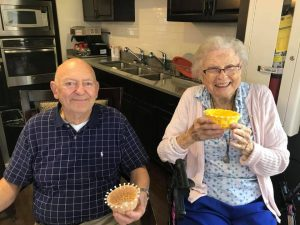 Madison Heights | Smiling seniors holding crafts