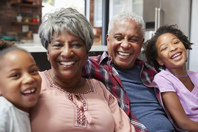 Atlas Senior Living | Senior couple with grandkids