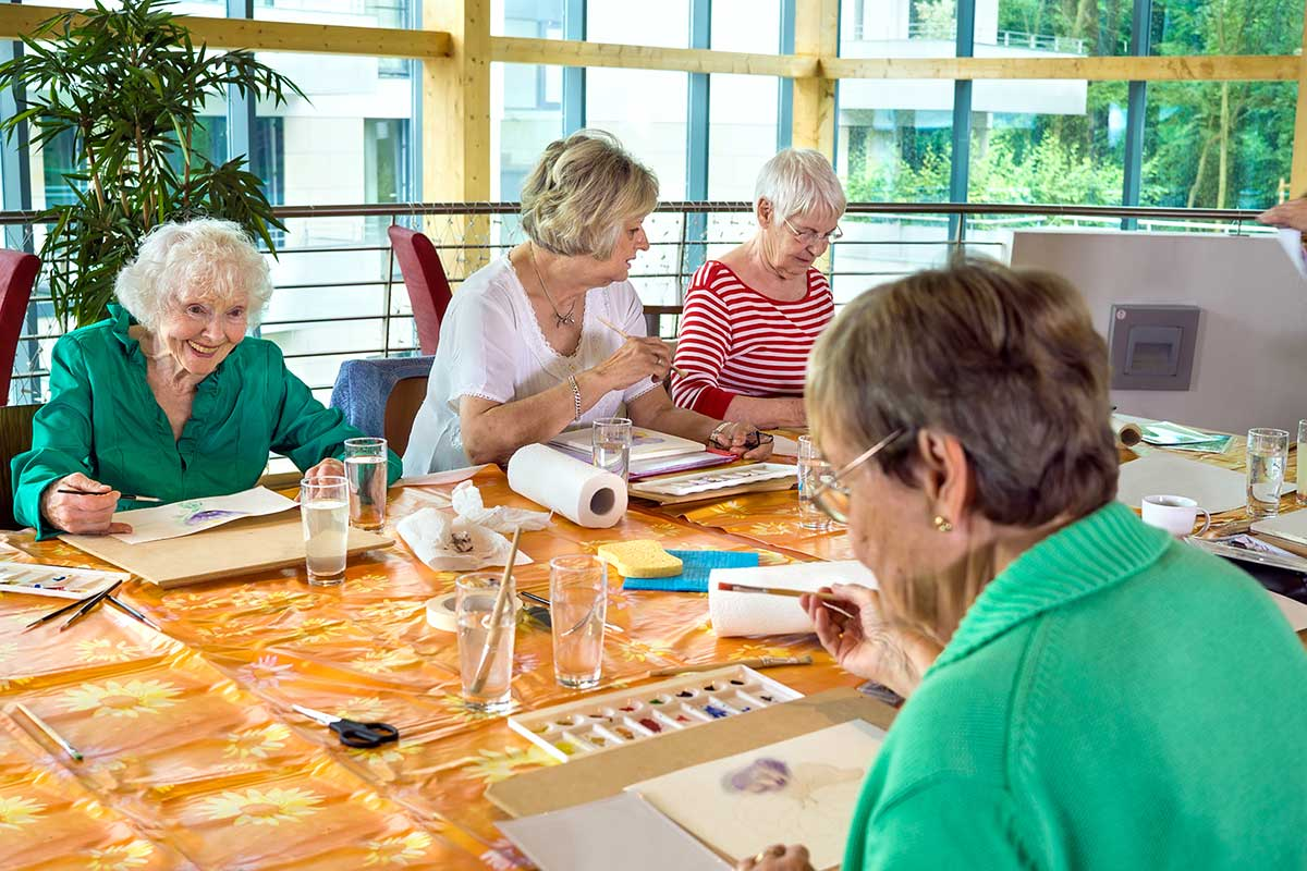 Atlas Senior Living | Senior women in painting class