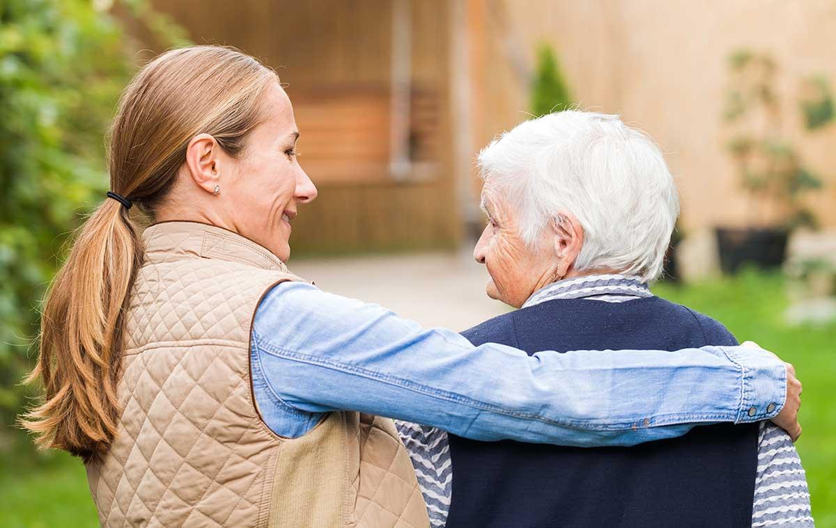 Atlas Senior Living | Woman with caretaker