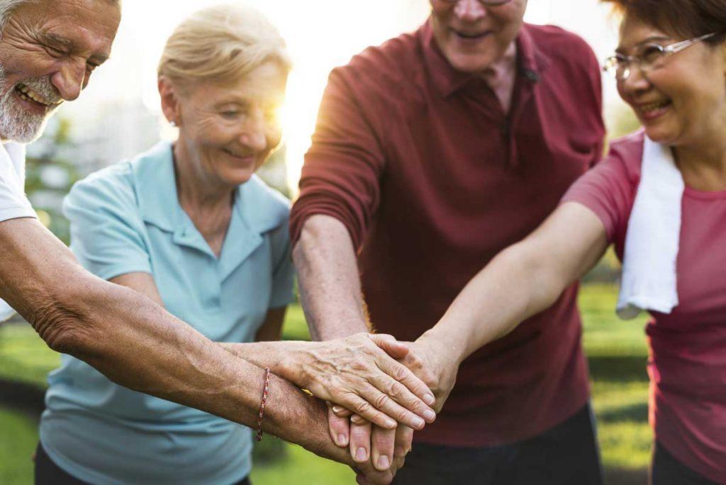 Atlas Senior Living | Seniors holding hands