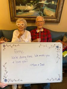 Legacy Ridge Trussville couple holding sign