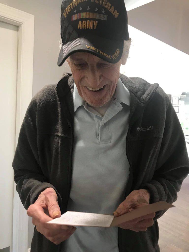 Madison Heights Evans   Senior man reading card