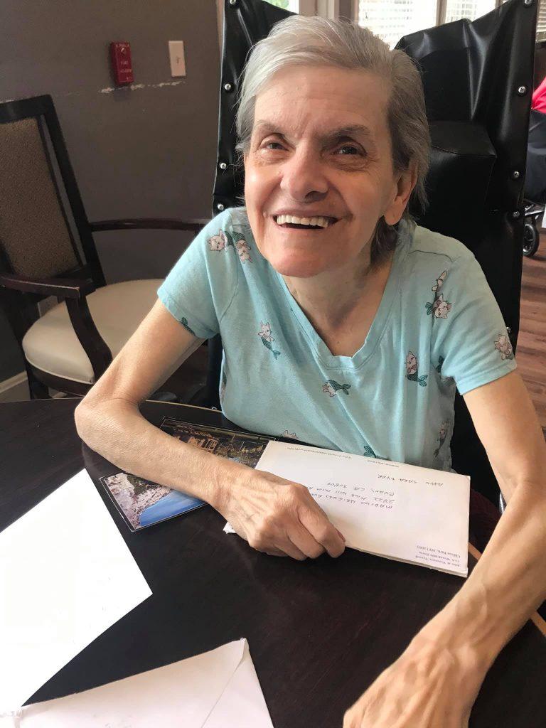 Madison Heights Evans   Senior woman receiving card