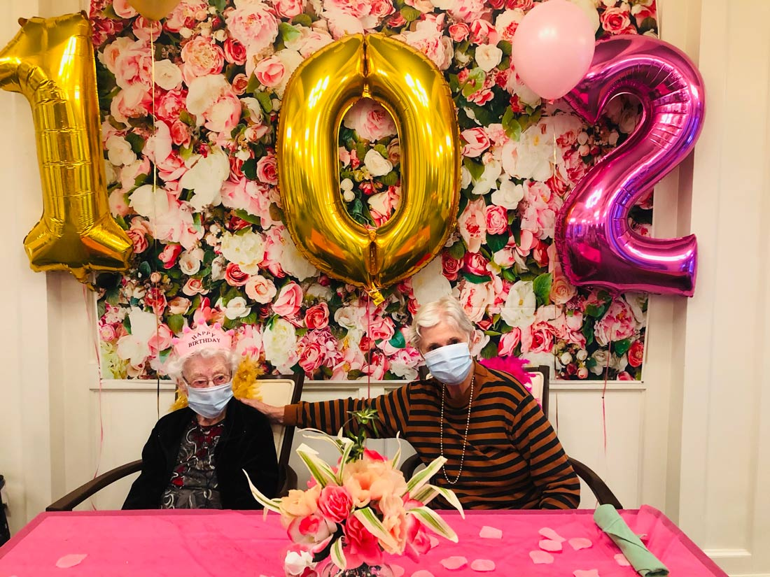 Atlas Senior Living | Clara with another resident on her birthday