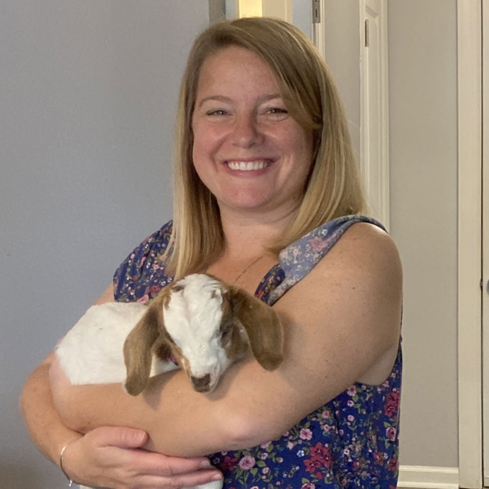 Madison Heights Evans | Woman with baby goat