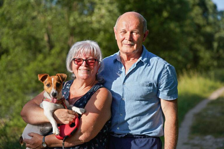 Atlas Senior Living   Senior couple with dog on trail