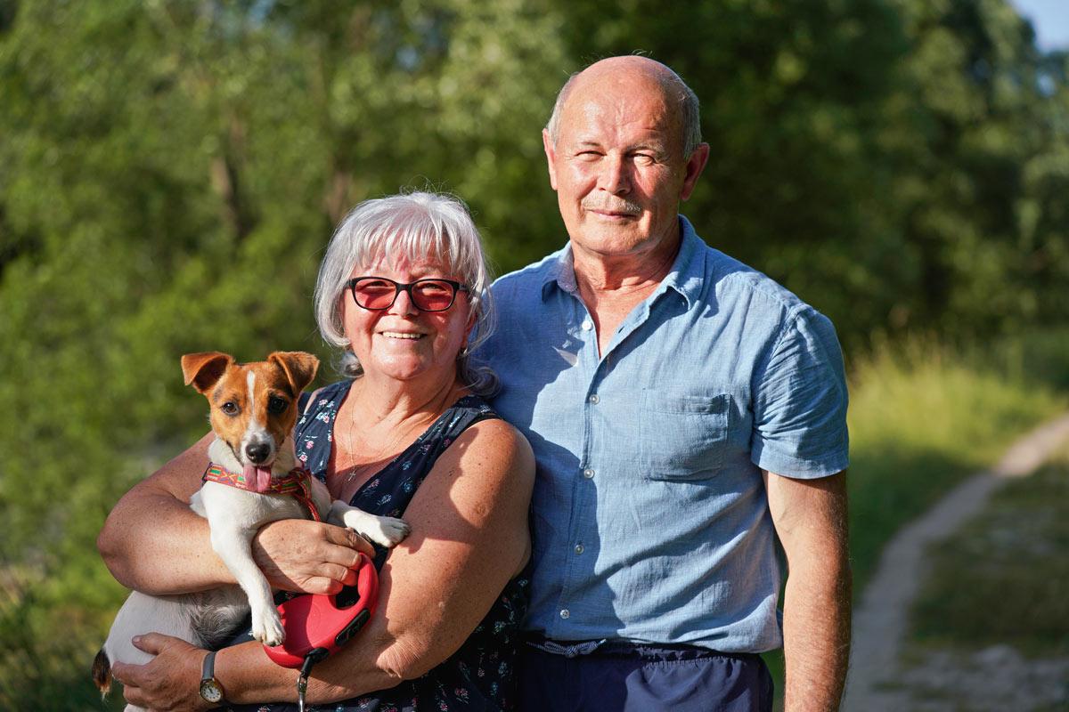 Atlas Senior Living | Senior couple with dog on trail