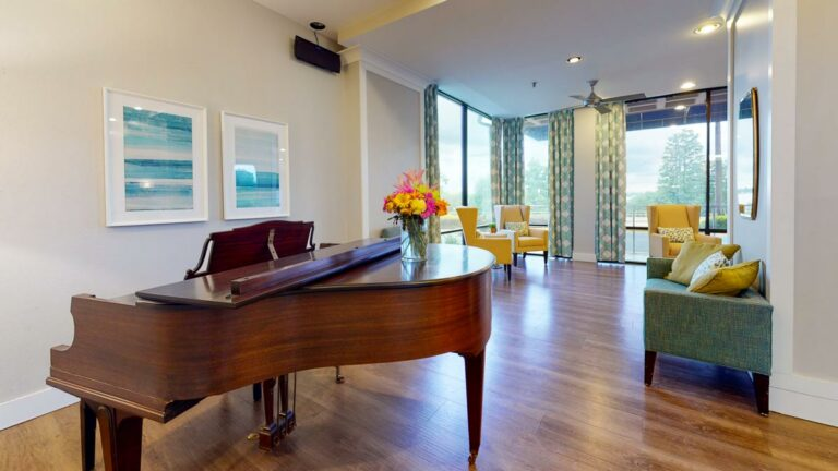 Lake Howard Heights | Piano and chairs in lobby