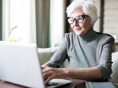 Atlas Senior Living | Senior woman using computer