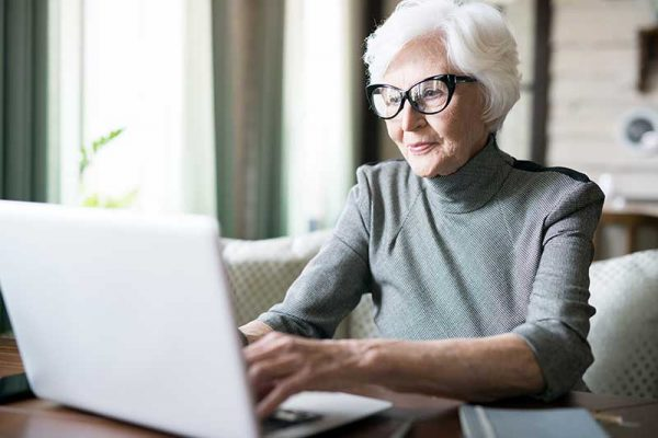 Atlas Senior Living | Senior woman using computer
